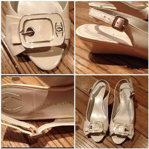 Ivory peep-toe heels with buckle detail