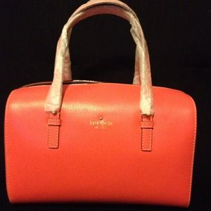 Brand new Kate Spade in coral 