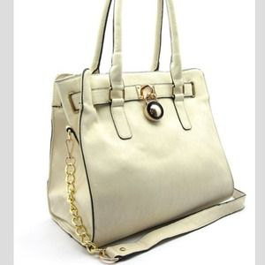 Beige handbag with gold chain strap