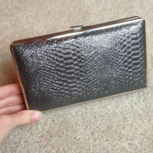 Silver faux snake skin clutch