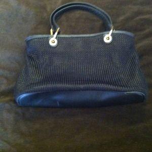 Blk purse. silk  basket weave material.