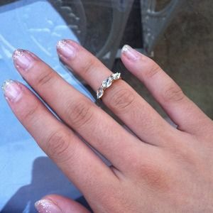 Cute crystal midi ring with pouch.