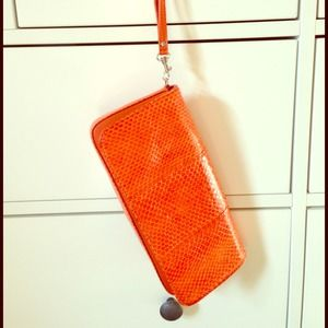 Orange snakeskin clutch/wristlet - Giani Bernini