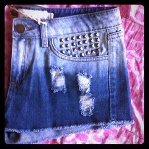 Distressed Jean shorts w/ studs