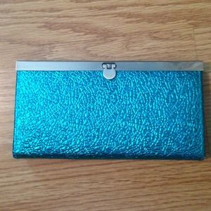 Metallic blue clutch purse