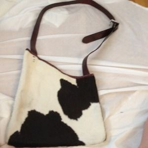 Used, Cow leather sling for sale