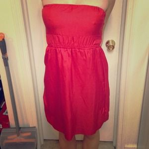 Red strapless dress.