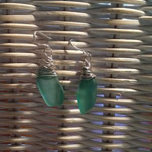 Teal sea glass earrings with sterling wire wrap.