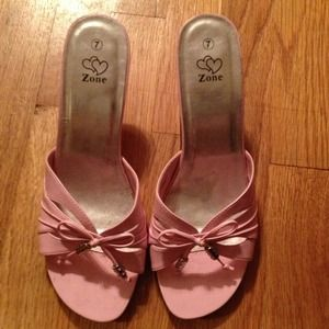Pink heels with rhinestones and bows in front