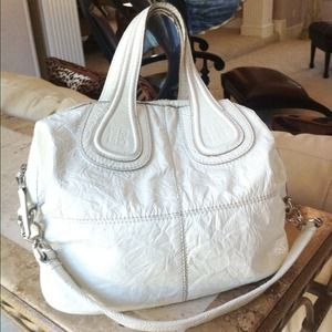 Negotiable Authentic GIVENCHY Nightingale