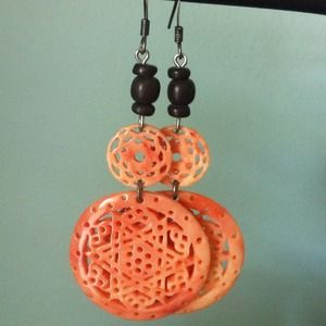 Bold coral earrings.