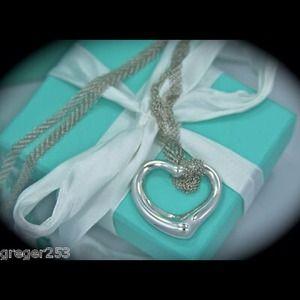 Tiffany & Co silver open heart charm
