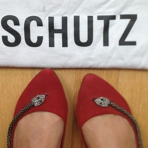 Snake adorned red Schutz flats