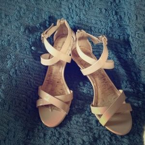 Nude wedge sandals.