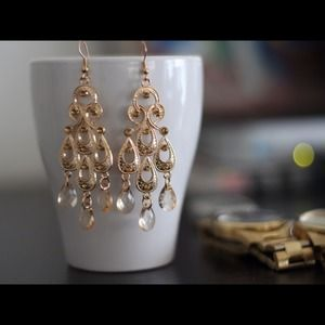 Gold chandelier earring, keep it cute at all time.