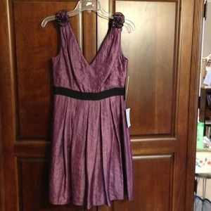 Stunning purple rosette cocktail dress