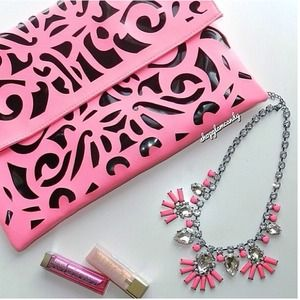 Clutches & Wallets - Neon pink laser cut clutch