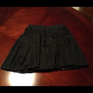Brand new Black lace skirt with flower detailing.