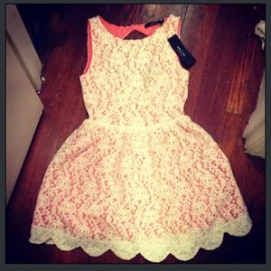 Lace dress with pink underlay