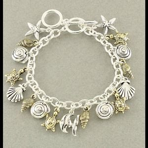 Jewelry - Sea charm bracelet, gold and silver tone