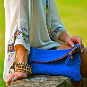 Looking for this Clare ViVier clutch!