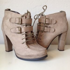 Light tan heeled booties.