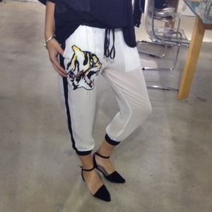 White crop pants with black drawstring and tiger