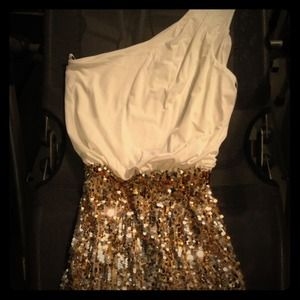 reducedWhite a gold sequin dress