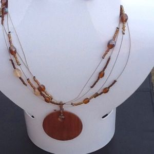 Jewelry - Wire necklace with wooden pendant
