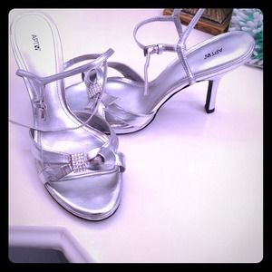 Formal silver heels with straps.