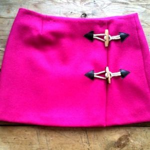 Pink wool mini skirt with floral lining