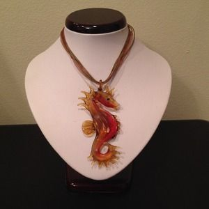 Glass orange/red seahorse pendant with necklace.