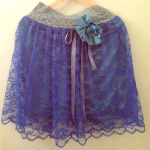 Blue lace skirt with flower ribbon