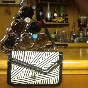 Henri Bendel Disturbed strip Clutch,gifted to cous