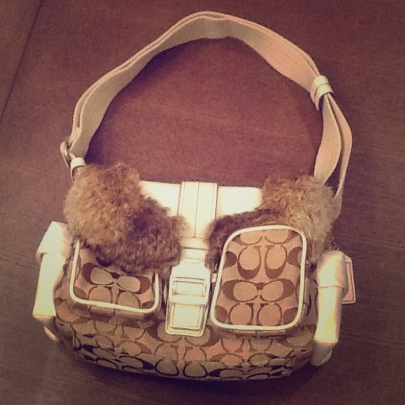 Genuine rabbit fur trim coach bag.