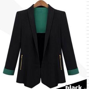 A beautiful black blazer with green cuffs