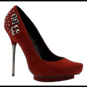 Red pumps with detail by Luichiny. Worn once!