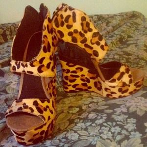 Sky high leopard wedges