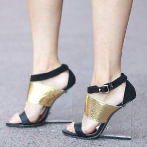 PRAVI CLEAR HEEL GOLD BLACK STRAP HEELS