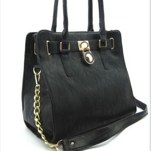 Black handbag with gold hardware and padlock