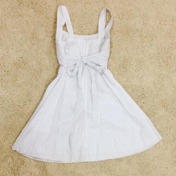 B smart white dress.