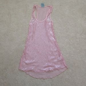 Size XS but fits like a S pink sequence top