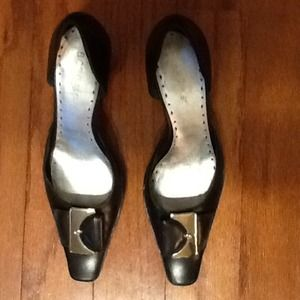 BCBG Black leather cutout pumps, 7 B.