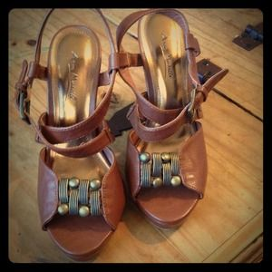 Brown sandals with mid size heel