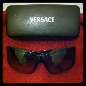 Versace black sunglasses with rhinestone detail.