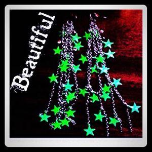 reduced green star earrings