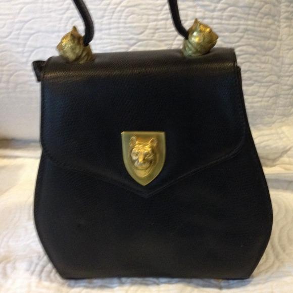 cc9d3e6819de larucchi Handbags - Vintage Larucchi lion heads purse. Retro!