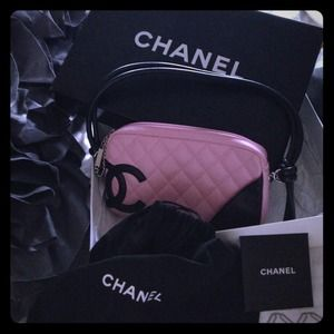 Authentic pink quilted Chanel shoulder bag.