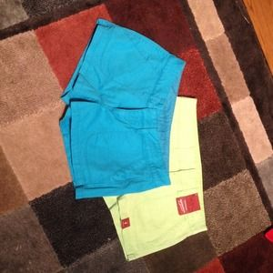 Two neon colored shorts