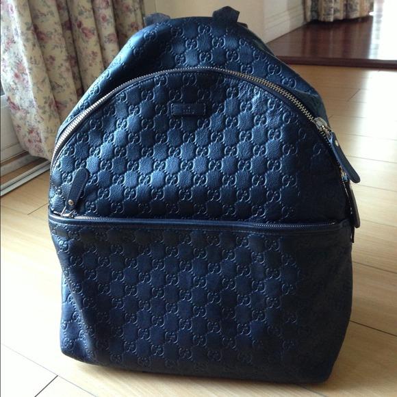 99049bcaa3da    SOLD    GUCCI zip backpack
